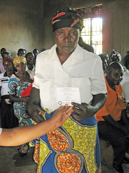 Janet receives her loan repayment certificate