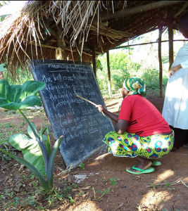 Janet learning at Tuunagane Women's School, Kyangwali Refugee Settlement, Uganda - Peopleweaver